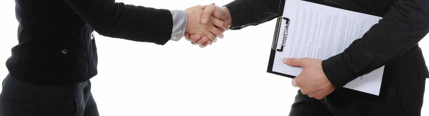 Woman and man shaking hands after signing a contract with Career Employment Service